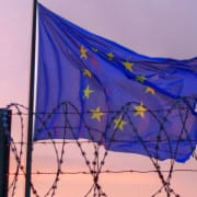 EU-flag-behind-barbed-wire-by-windytan